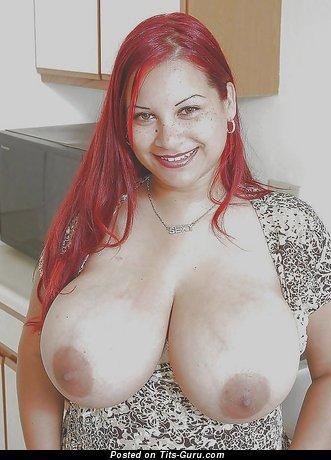Изображение. Фотография сексуальной обнажённой рыжей с большими натуральными дойками