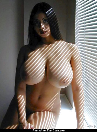 Topless brunette with big natural tittys and big nipples picture
