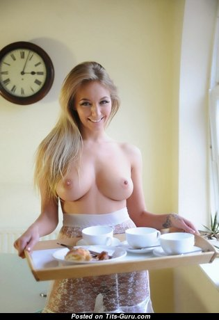 Sexy topless blonde with natural boobies image