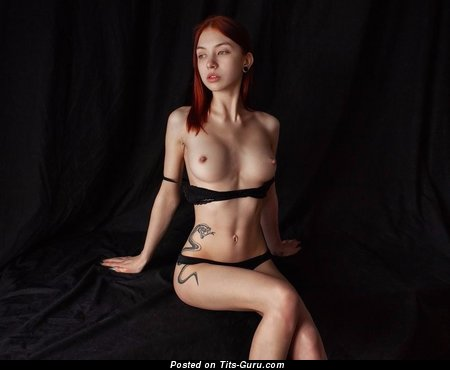 Image. Red hair with tattoo picture