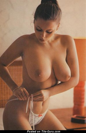 Joanne Latham: nude brunette with medium natural tits vintage