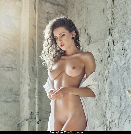 Nude hot woman with medium natural breast photo