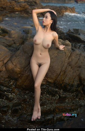 Huang Ke - nude asian with medium natural tittes photo