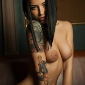 Brunette with medium breast and tattoo picture