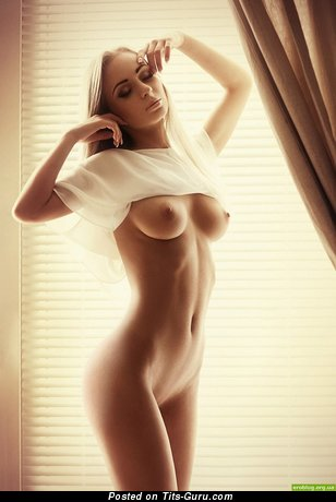 Image. Nude blonde with medium natural boobies photo