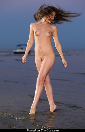 Image. Naked wonderful girl with small natural tots photo