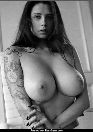Alluring Unclothed Chick with Tattoo (Sexual Photoshoot)