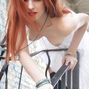 Sexy red hair with medium natural boobies picture