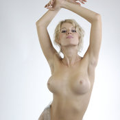 Topless blonde with big tots picture