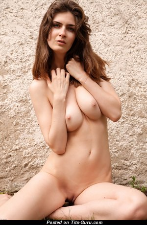 Image. Naked brunette with medium natural tits image