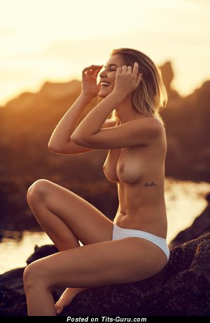 Sexy naked beautiful girl with medium natural tots and tattoo image