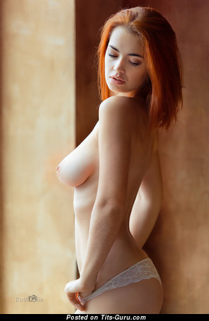 Image. Topless red hair with medium natural boobs image