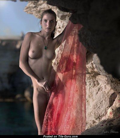 Image. Nude wonderful woman with medium natural tots photo