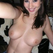 Topless amateur brunette with medium natural tits selfie