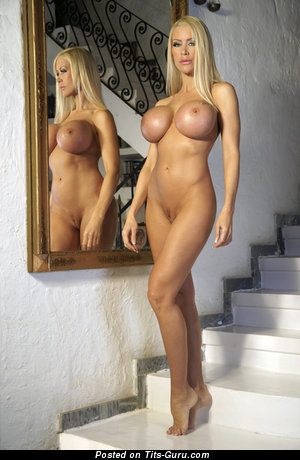 Image. Nude blonde with huge fake tots pic