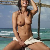 Topless brunette with medium natural tots picture