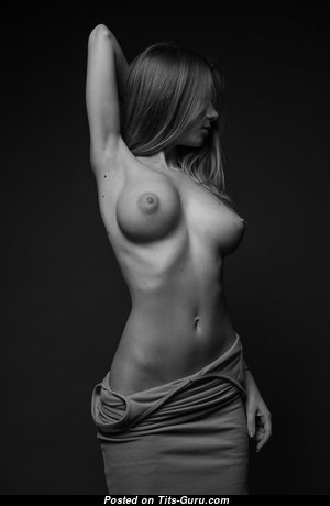 Topless blonde with fake tittes & big nipples photo