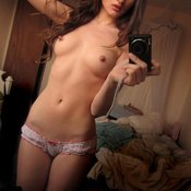 Topless amateur awesome female with small natural tots and piercing photo