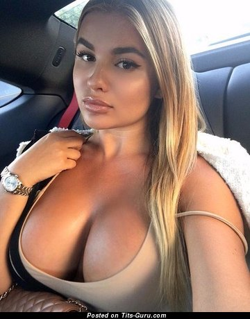 Image. Amateur hot lady with big fake tittes selfie