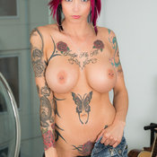 Anna Bell Peaks - red hair with big fake breast, piercing and tattoo photo
