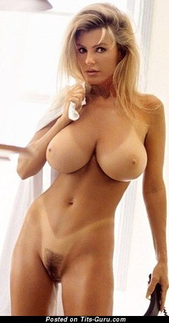 Nude blonde with huge tots image
