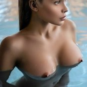 Sexy wet topless amazing lady with medium natural boobs pic