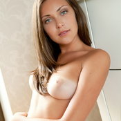 Brunette with medium natural boob image