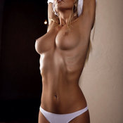 Sexy naked blonde with medium natural boobies photo