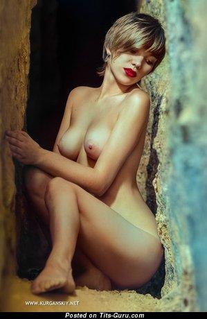 Image. Nice girl with medium natural tots pic