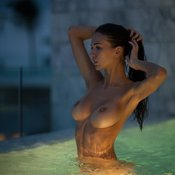 Sexy topless brunette with natural boobs image