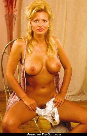 Deborah Corrigan - Alluring Topless British Blonde with Alluring Exposed Dd Size Knockers (18+ Image)