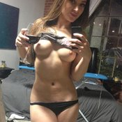 Sexy topless amateur wonderful female with medium natural tittes selfie