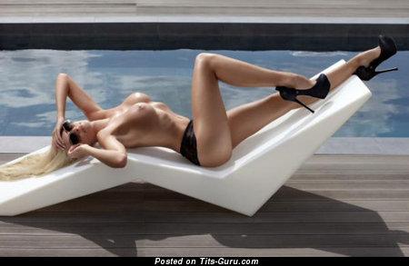 Image. Nude beautiful woman with medium breast photo