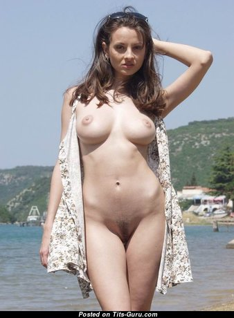 Adorable Babe with Adorable Naked Real Mid Size Knockers is Undressing on the Beach (Xxx Image)