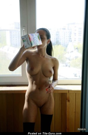 Image. Naked brunette with medium natural tittys picture
