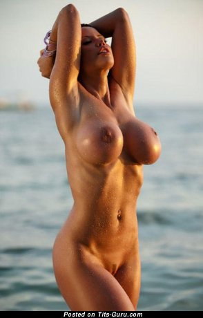 Image. Nude beautiful woman with fake boob photo
