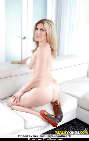 Cory Chase - Awesome American Blonde Pornstar with Graceful Exposed Fake Dd Size Melons in High Heels (Porn Photo)