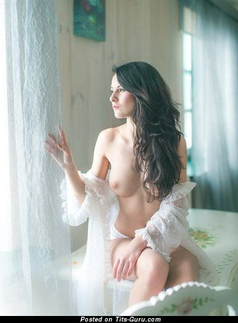 Image. Nude brunette with medium natural tits pic