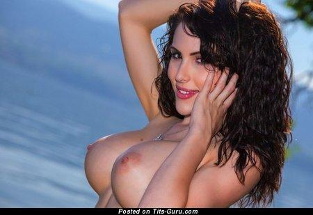 Image. Beautiful female with big fake boob photo