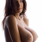 Beautiful female with huge natural boobs photo