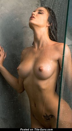 Image. Sexy wet topless brunette with medium natural boobs and big nipples picture