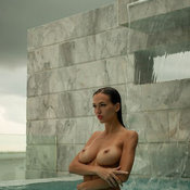 Wet wonderful girl with natural tittes photo