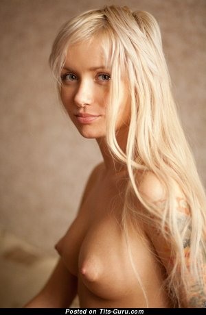 Image. Nude blonde with medium natural boobies pic