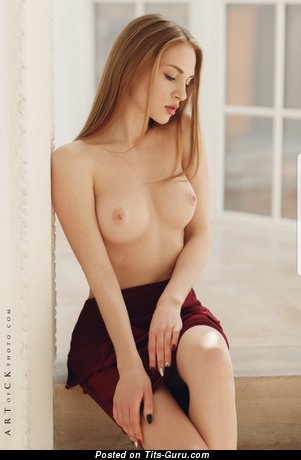Sexy topless blonde with small natural boob picture