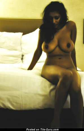 Image. Naked latina with medium tittes picture