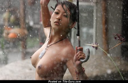Image. Wet asian brunette with medium tittys picture