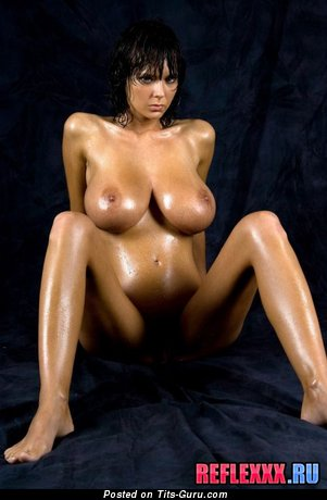 Image. Wet brunette with huge natural tittys picture