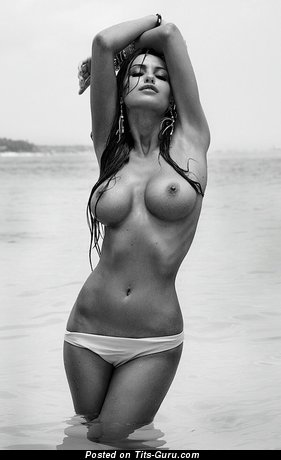 Image. Sexy wet naked brunette with big fake boobs and big nipples image