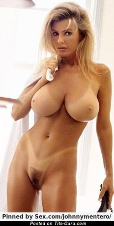Naked awesome female with huge tots pic