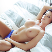 Topless brunette with big boobs photo